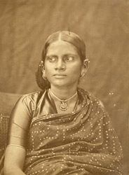 Head and shoulders portrait of a young South Indian woman, Madras.